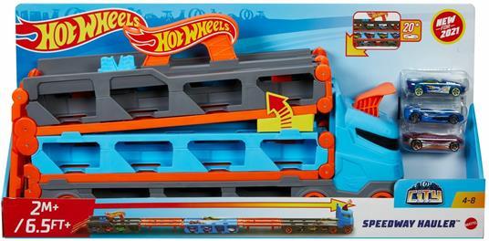 Hot Wheels 2in1 Camion Trasportatore e Pista con 3 Macchinine,Giocattolo per Bambini 4+Anni. Mattel (GVG37)