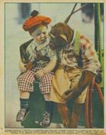 Consiglio di guerra? Il bambino e lo scimmiotto sono ottimi amici, compagni di giuochi : ora, in assetto di cow. boy, con i loro bravi pistoloni al fianco, essi forse studiano un piano d'azione